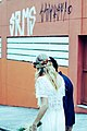 Wedding couple walks down street in Santo André (Unsplash).jpg