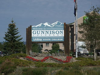 Gunnison, Colorado - Welcome to Gunnison sign for travelers on Hwy 50 entering Gunnison from the east.