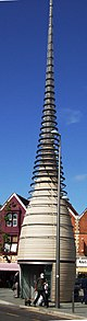 A tapering tower, with metal hoops around the upper part.