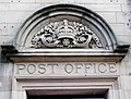 Whitby ... above the doorway of the former Post Office. (5769491872).jpg