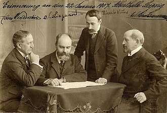 Sergei Lyapunov - Conductor Hans Winderstein (far left), Sergei Lyapunov, pianist Ricardo Viñes (standing) and publisher Julius Heinrich Zimmermann (far right) in Leipzig in 1907.