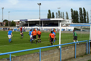 Wivenhoe Town F.C. - Wivenhoe (in orange) playing against Wingate & Finchley.
