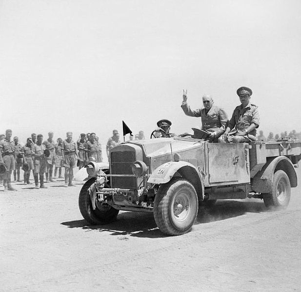 File:Winston Churchill giving his famous V-for-Victory sign while being driven past a line of troops in Tel-el-Kebir, 9 August 1942. E15387.jpg