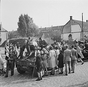 XXX Corps (United Kingdom) - Vehicles of the Guards Armoured Division of XXX Corps passing through Grave having linked up with the US 82nd Airborne Division.