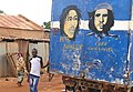 Young Man Poses with Bob Marley-Che(e) Guevara Mural on Back of Delivery Truck - Ouagadougou - Burkina Faso.jpg