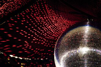 Disco - The reflective light disco ball was a fixture on the ceilings of many discothèques