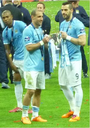 2014 Football League Cup Final - Manchester City's Pablo Zabaleta and Álvaro Negredo holding the trophy after the final