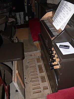 Pedal keyboard - This 1609 organ shows the short, button-style pedals of early pedal setups