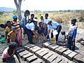 (UNPOL) de la MONUSCO encourage les familles victimes de conflits à fabriquer des briques pour la reconstruction de leurs maisons. (14843010780).jpg