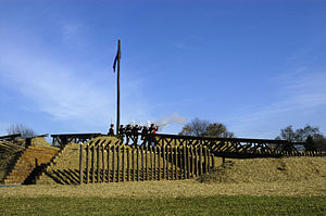 U.S. Army Heritage and Education Center - Re-enactors fire from an American Revolutionary War redoubt on the Army Heritage Trail. It is a replica of Redoubt 10, a British redoubt seized by Continental Army troops at the Siege of Yorktown on October 14, 1781.