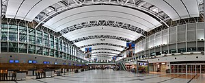 Airport check-in - Panorama of a modern airport check-in hall at Ezeiza International Airport in Buenos Aires