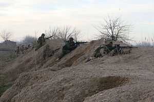 Operation Moshtarak - Marines and Afghan National Army soldiers take cover in Marja on February 13