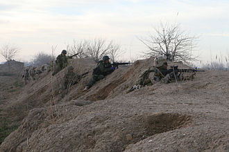 Operation Moshtarak - Marines and Afghan National Army soldiers take cover in Marja on February 13.