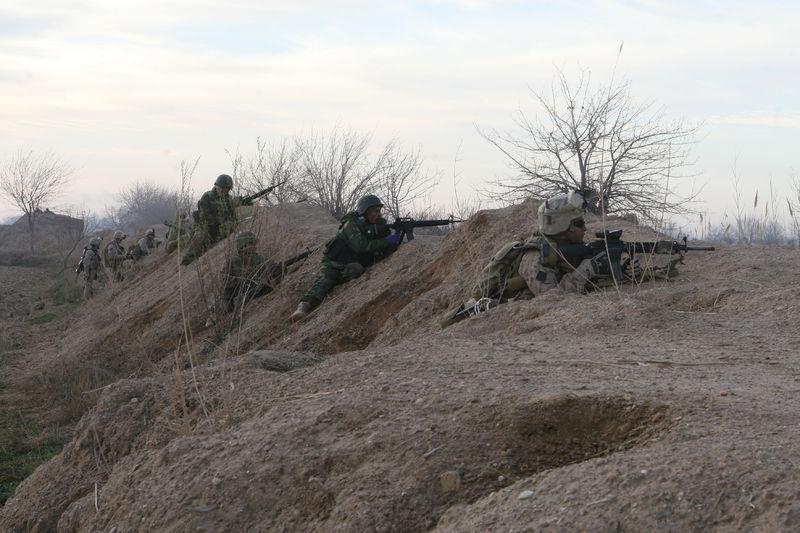1st Battalion 6th Marine Regiment take cover outside Marjah.jpg