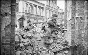 two men in a rubble strewn street