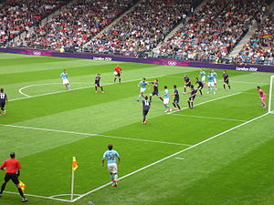 Football at the 2012 Summer Olympics – Men's tournament - Juan Mata taking a corner in the match between Spain and Japan