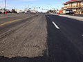2014-09-09 09 03 10 Asphalt milled in preparation for new asphalt overlay with new overlay partially applied on Idaho Street (Interstate 80 Business and Nevada State Route 535) in Elko, Nevada.JPG
