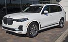 2019 BMW X7 xDrive40i in white, front left.jpg