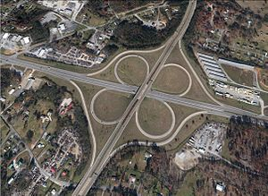 Bradley County, Tennessee - Aerial view of the cloverleaf interchange of APD-40 (U.S. 64 Byp./S.R. 60) and U.S. Route 64 (Inman Street/Waterlevel Highway).