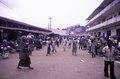 ASC Leiden - F. van der Kraaij Collection - 05 - 041 - A waterside open air market with people. To the right Choithram & Sons (Liberia), Inc - Monrovia, Waterside, Montserrado, Liberia, 1975.tif