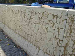 Concrete degradation - Typical crack pattern associated to the alkali-silica reaction affecting a concrete step barrier on a US motorway (photograph, courtesy of the Federal Highway Administration, US Department of Transportation).