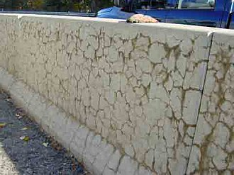 Alkali–silica reaction - Characteristic crack pattern associated with the alkali–silica reaction affecting a concrete step barrier  on a US motorway