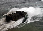 A U.S. Marine Corps assault amphibious vehicle exits the well deck of the amphibious dock landing ship USS Tortuga (LSD 46), not shown, to participate in a joint exercise with the Royal Malaysian Navy June 21 130621-N-IY633-029.jpg