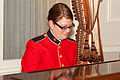 A U.S. Marine plays the piano during the Evening Parade reception at the Home of the Commandants in Washington, D.C., May 24, 2013 130524-M-MM982-004.jpg