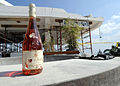 A bottle of wine pulled from the rubble of the Hotel Montana is photographed March 13, 2010, in Port-au-Prince, Haiti 100313-N-HX866-001.jpg