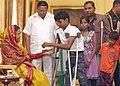A handicapped child tying 'Rakhi' to the President, Smt. Pratibha Devisingh Patil, on the occasion of 'Raksha Bandhan', in New Delhi on August 13, 2011.jpg