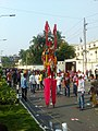 A stilt walker at Shahid, Dhaka .jpg