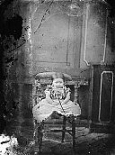 A young girl sitting on a chair NLW3364661.jpg