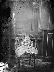 A young girl sitting on a chair