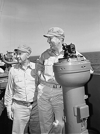 Arthur W. Radford - Radford (right) with Captain Joseph J. Clark aboard USS Yorktown, October 1943