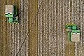 Aerial view of two cotton harvesters making horizontal stripes in Batesville, Texas field.jpg