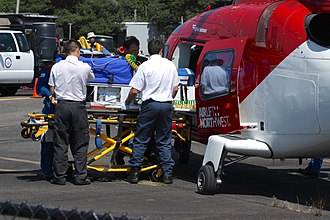 Ambulance - Patient being loaded into an medical helicopter