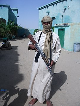 Al-Qaeda militant in Sahel armed with a Type 56 assault rifle, 2012 Al-Qaida cree une brigade dirigee par des Touaregs (8246938011).jpg