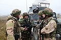 Albanian soldiers discuss their mission during a military adviser team (MAT) and police adviser team (PAT) training exercise at the Hohenfels Training Area, a part of the Joint Multinational Readiness Center 131213-A-LO967-003.jpg