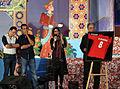 Ali Karimi reveals his football shirt in a charity celebration.jpg