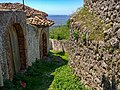 Alley by the antient wall - Castle grounds Kruja, Albania.jpg
