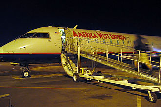 America West Express - A traveler boards an America West Express CRJ-200 regional jet operated by Mesa Airlines at the Las Vegas airport.