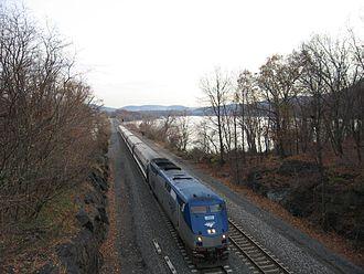 Empire Service - GE Genesis P32AC-DM No. 701 pulls an Empire Service through the Hudson Highlands along the Hudson River.