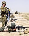 An Iraqi soldier fires an M14 sniper rifle as an Australian soldier, attached to Task Group Taji, spots a target for him.jpg