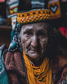 An old Kalash woman in tradational outfit.jpg