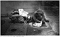 Apparently homeless man doing crossword.jpg