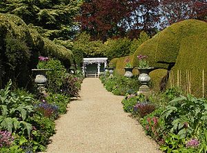 "Ascott House - The ""Madeira Walk"", a path between two mirror herbaceous borders, terminated by George Devey's classical pavilion"