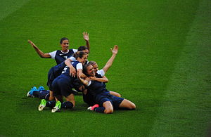 Shannon Boxx - Boxx and the USWNT celebrate after a goal in the Gold medal match against Japan, at the 2012 Summer Olympics. Back to front: Boxx-7, Wambach-14, O'Hara-5, Morgan-13, Lloyd-10