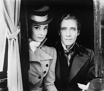 Audrey Hepburn and Mel Ferrer, posed in costum...
