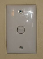 "A typical ""down"" light switch — this one is on. The design shown here is prevalent Australia-wide."