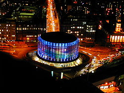 An aerial photograph of the BFI IMAX theatre in London at night